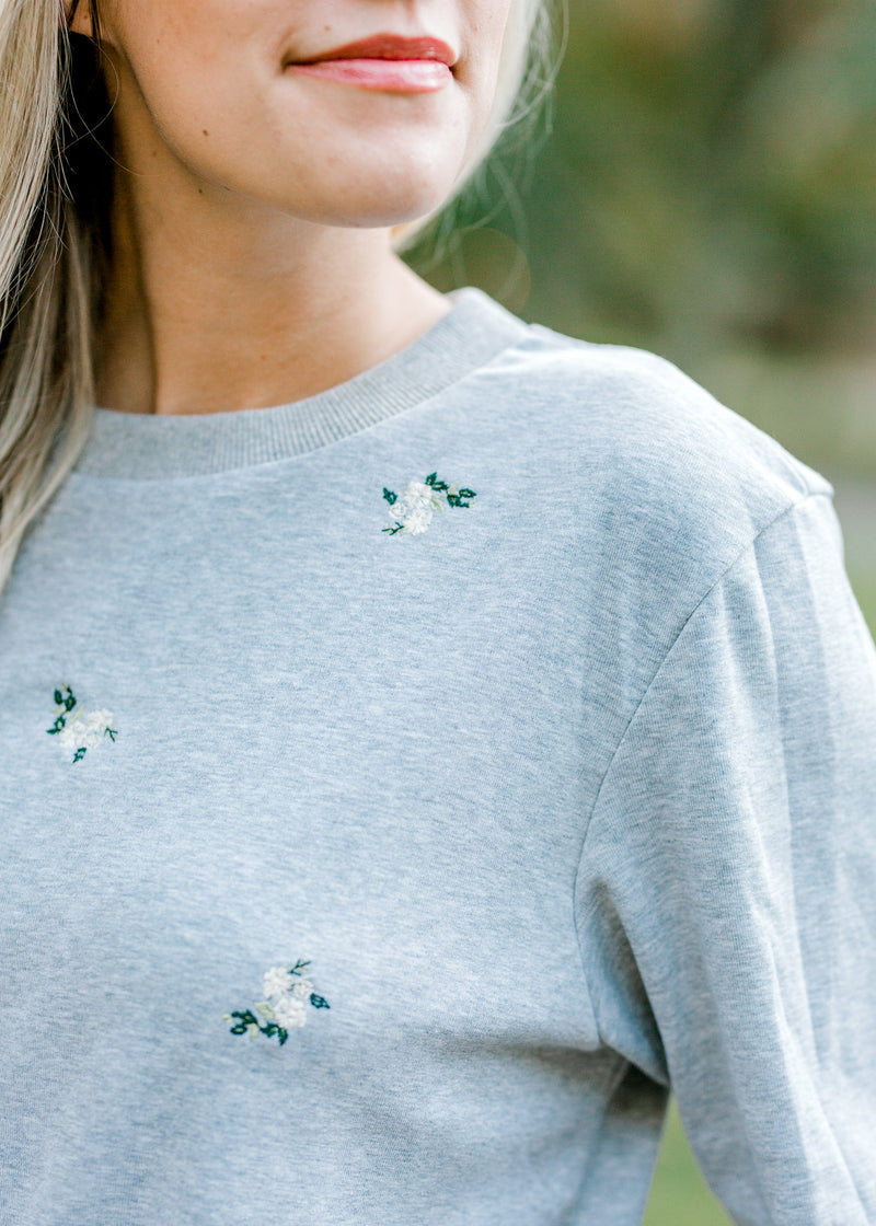 bouquet of flowers on gray sweatshirt - epiphany boutiques