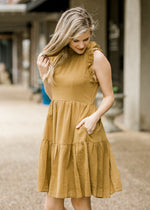 detailed view of golden green dress - epiphany boutiques