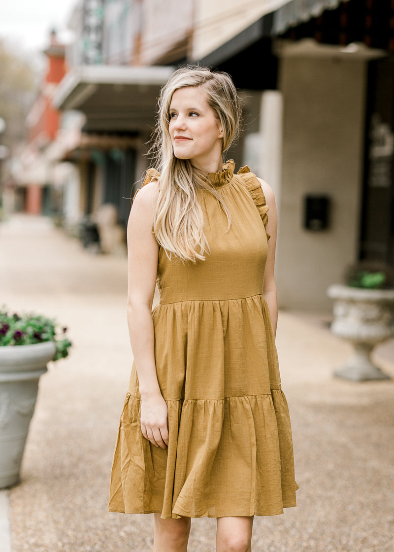 model in mossy green dress - epiphany boutiques