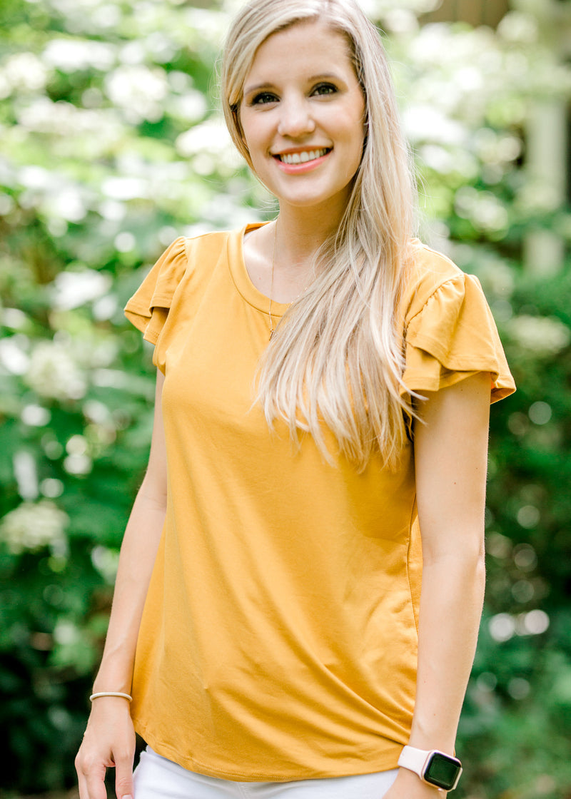 model wearing a mustard top with a tulip sleeve detail - epiphany boutiques