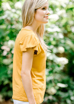ruffled sleeve on mustard top - epiphany boutiques