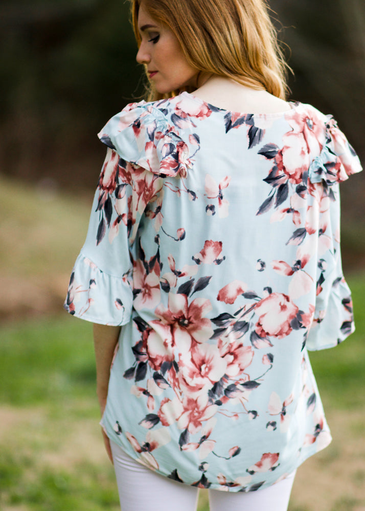 ruffle sleeve-ruffle on the shoulder-soft blue green background-with pink and cream roses-Name of the Rose Top