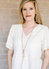 natural beaded cross necklace - epiphany boutiques
