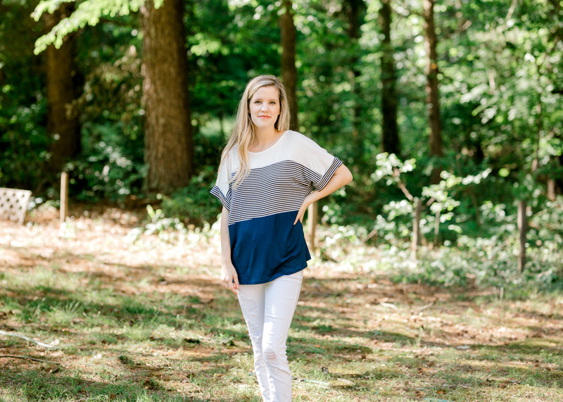 model in a navy colorblock top - epiphany boutiques