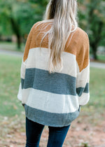 model wearing a color block sweater - epiphany boutiques