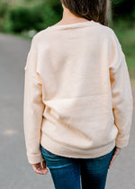 B The Pale Peach Sweater for the Bump