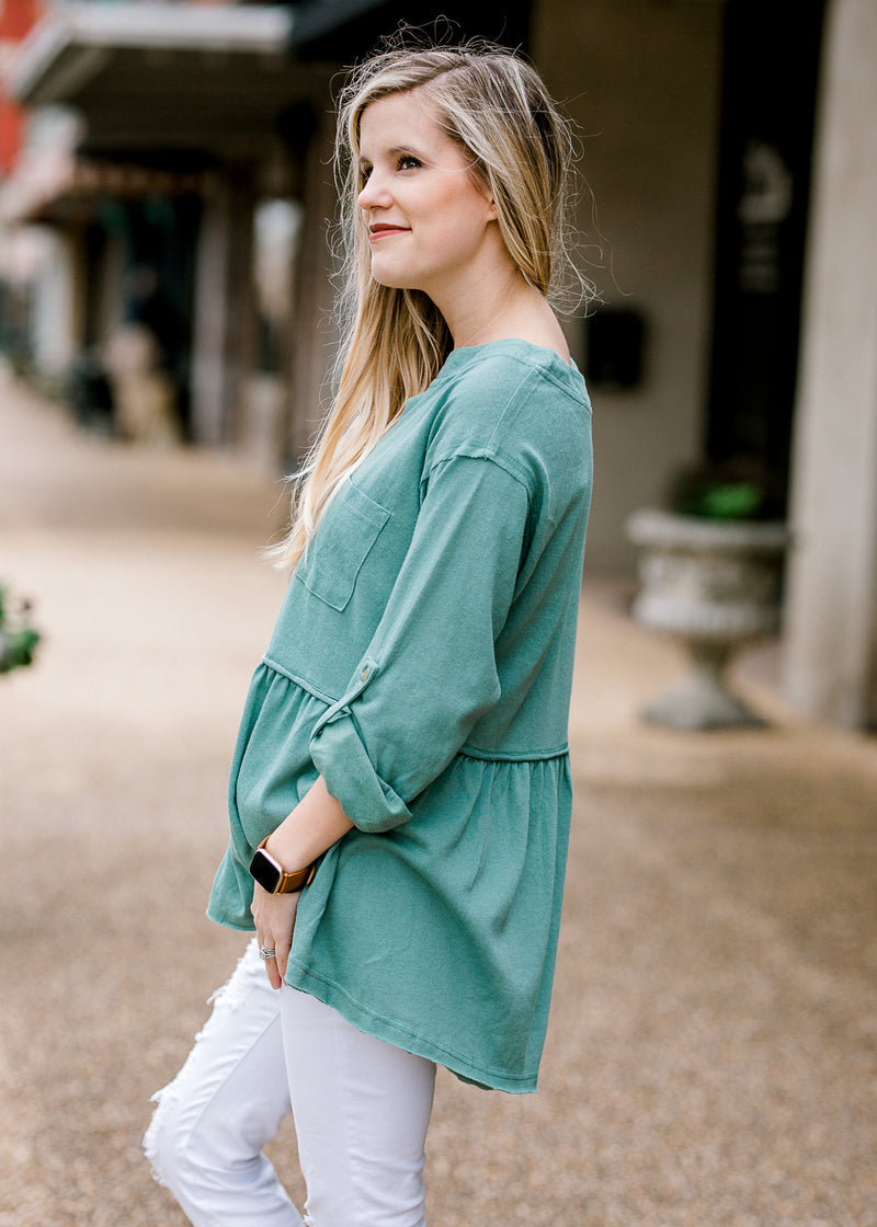 model in a dusty teal top - epiphany boutiques