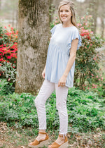model in blue top - epiphany boutiques