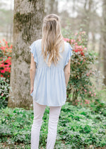 soft blue ruffled back view - epiphany boutiques