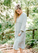 sage midi dress with long sleeves - epiphany boutiques