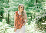 model in rust top with ruffles - epiphany boutiques