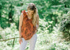 model in rust top with leaf print - epiphany boutiques
