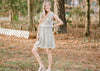 dusty sage dress with ruffles and embroidery - epiphany boutiques