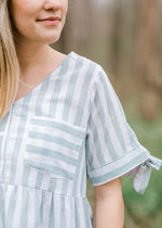 sage pocket top with tie detail- epiphany boutiques