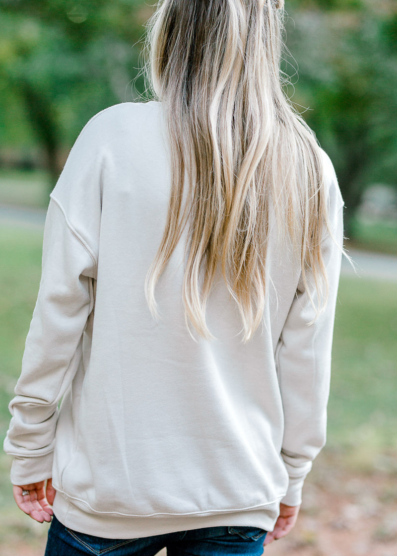 model in a cream oversized sweatshirt -  epiphany boutiques