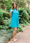 model in a aqua dress with key hole - epiphany boutiques
