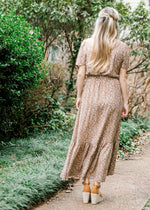 back view of golden brown maxi - epiphany boutiques