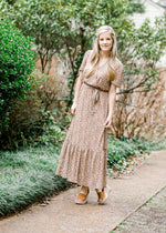 model in a v neck maxi dress - epiphany boutiques