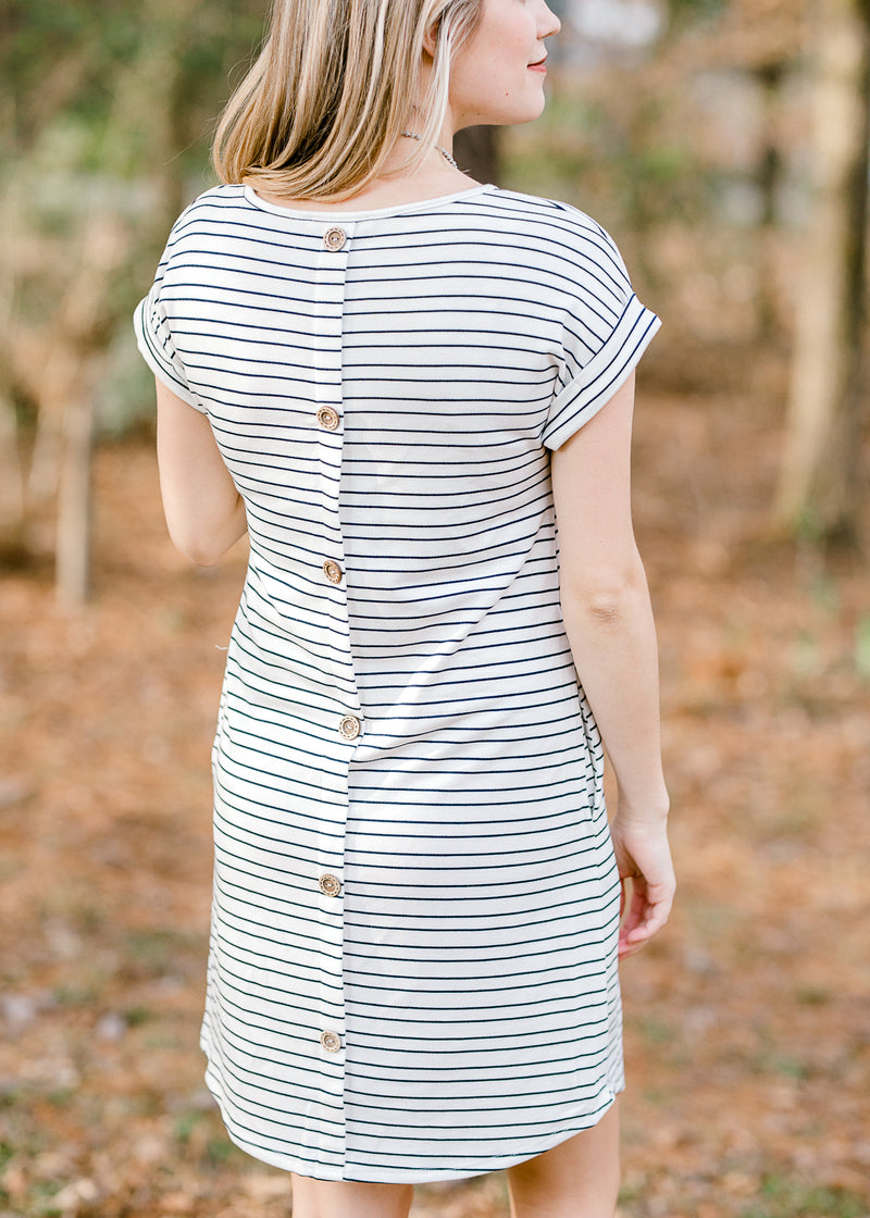 button detail on back of navy and cream dress - epiphany boutiques