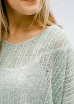 model in sage lightweight sweater - epiphany boutiques