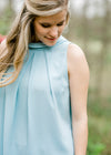pleated top in soft blue - epiphany boutiques