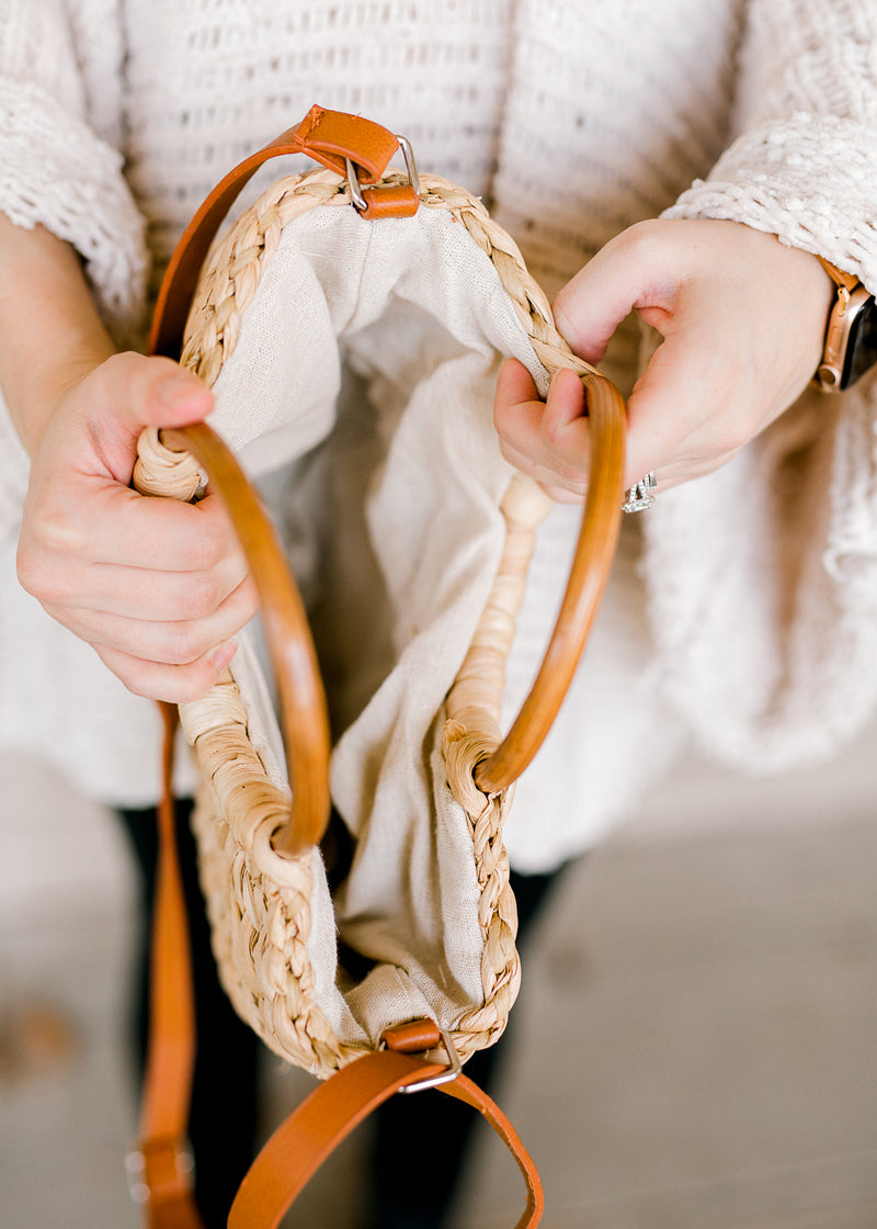 wooden handle on straw purse - epiphany boutiques