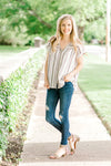 model wearing striped top with buttons - epiphany boutiques