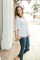 model in tassel top with v neck -epiphany boutiques
