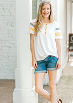 model in varsity striped tee - epiphany boutiques