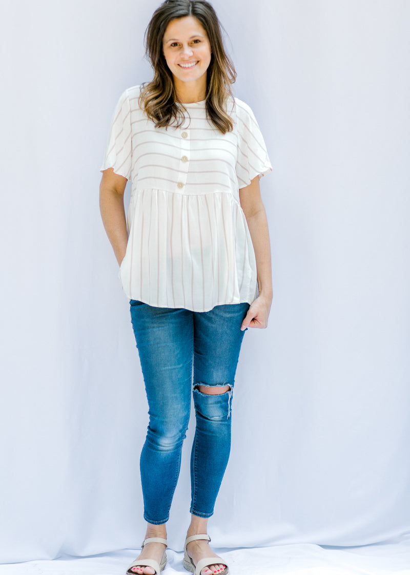model in cream and taupe stripe top - epiphany boutiques