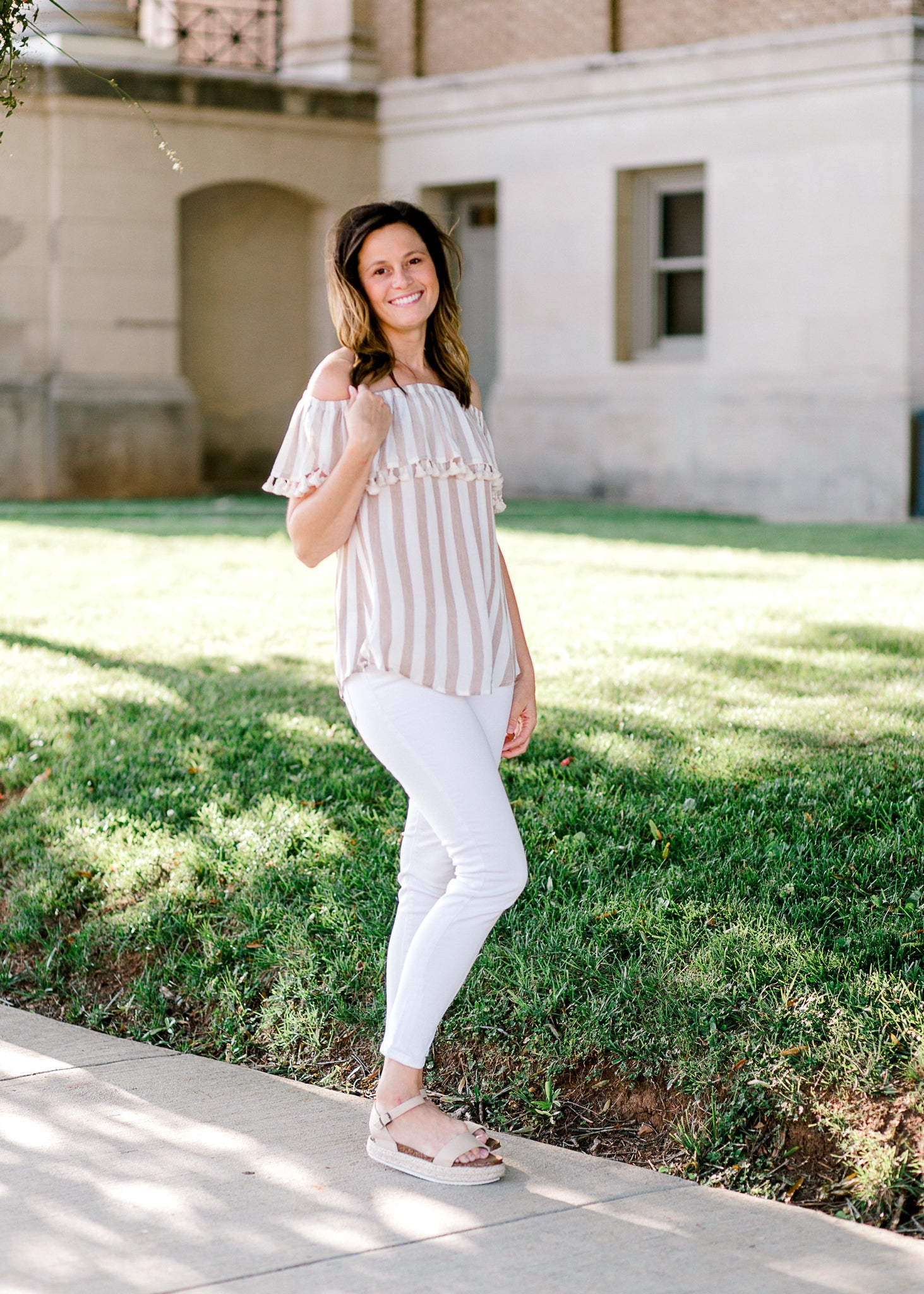 model in taupe and white top off the shoulder - epiphany boutiques