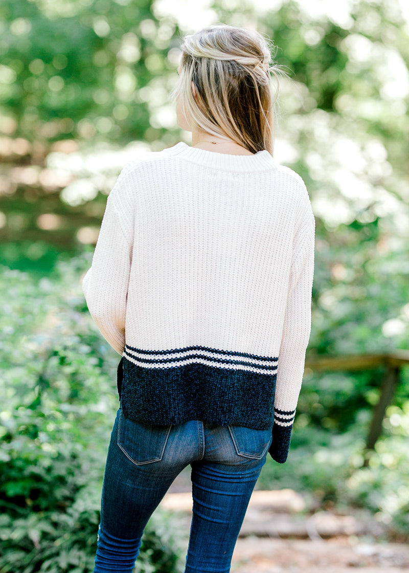 back view of a cream and navy block sweater - epiphany boutiques