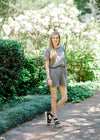 model in a charcoal short sleeve romper with pockets - epiphany boutiques