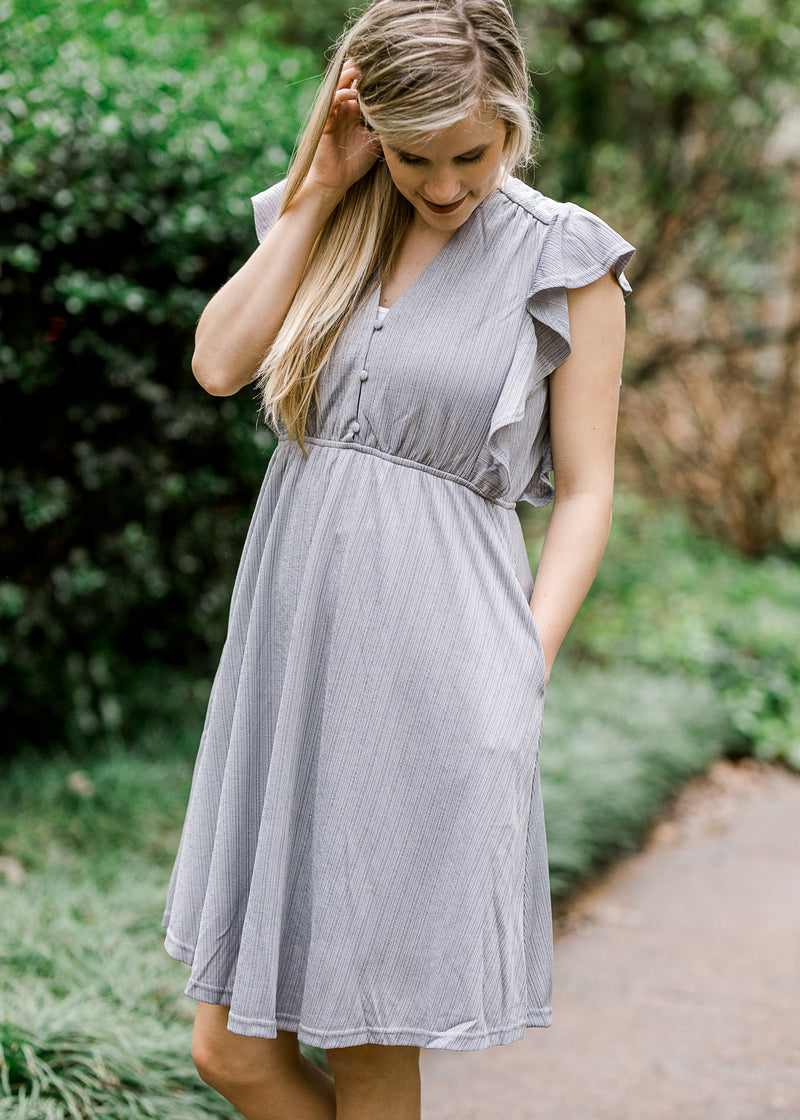 model wearing a lavender dress - epiphany boutiques