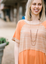 model in warm peach top - epiphany boutiques
