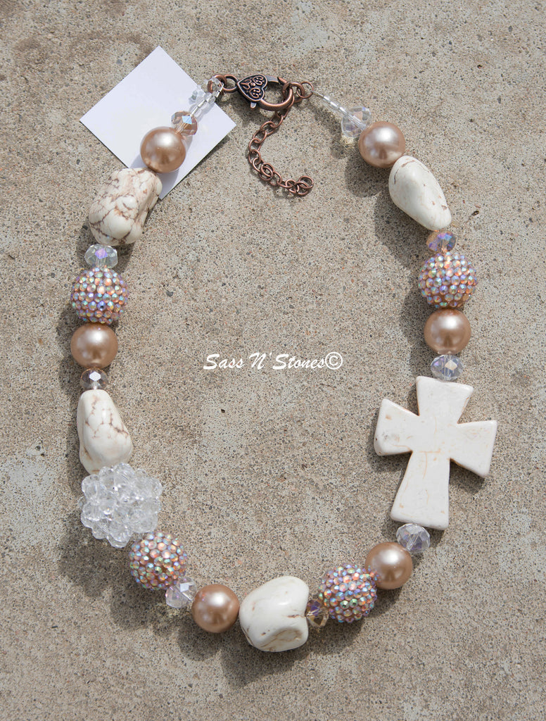 Neutral Colored Necklace with Offset Crystal Ball and White Cross