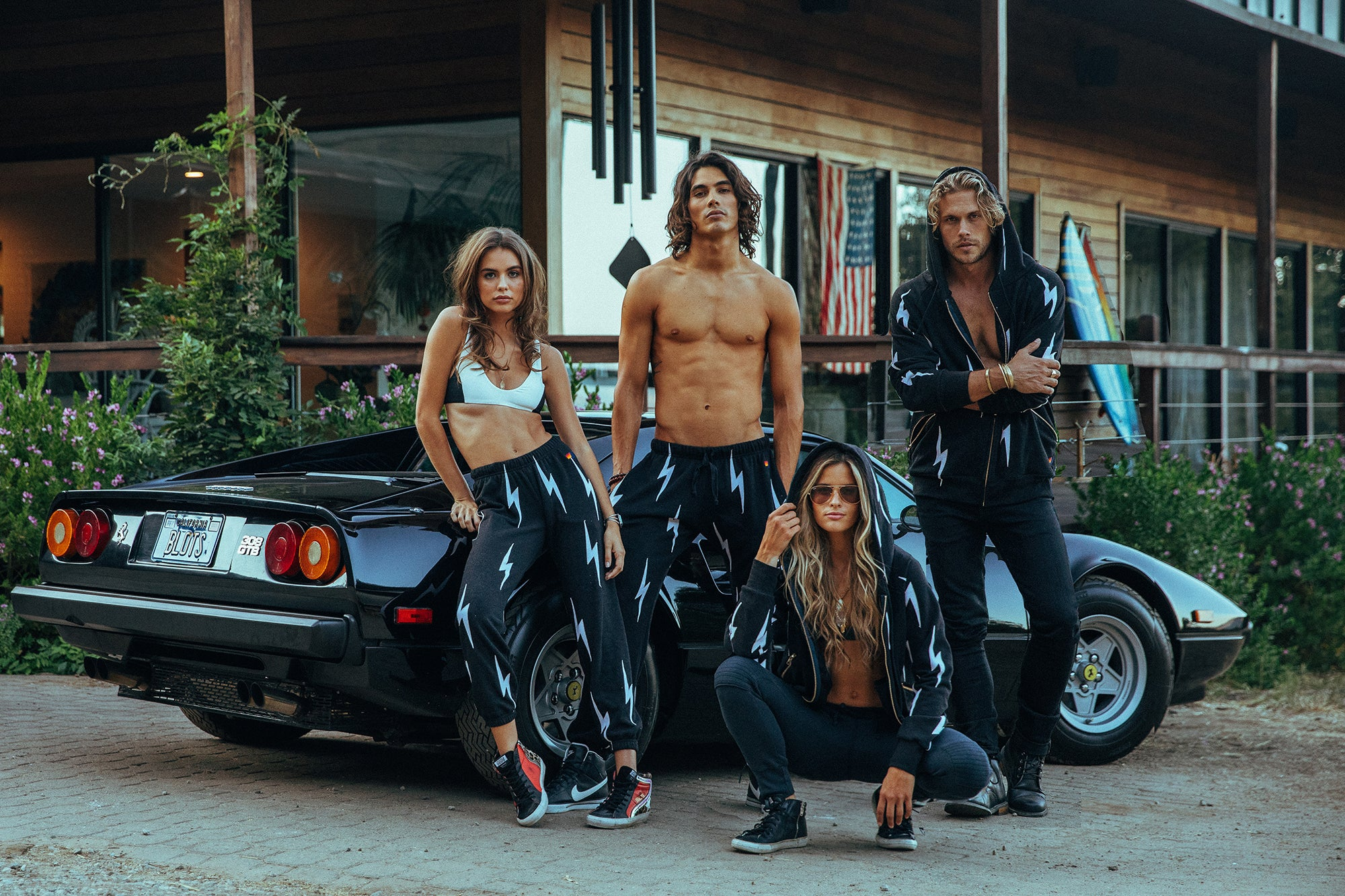 Models posing in-front of a car