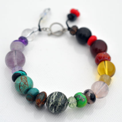 Balance Chakra Bracelet with Silver Clasp. Crystals may vary from  hematite, smoky quartz, brecciated jasper, sardine coral, red aventurine, orange moonstone, carnelian, yellow tiger eye, yellow fluorite,  yellow jasper, green chalk turquoise, rhodonite, pink talcum, rose quartz, new jade malachite, labradorite, natural turquoise, lapiz, dark lepidolite, dark amethyst, light amethyst, white jade, howlite, clear quartz