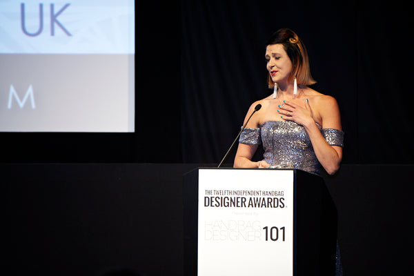 Jennifer Hamley accepting award in New York City Independent Handbag Designer Awards
