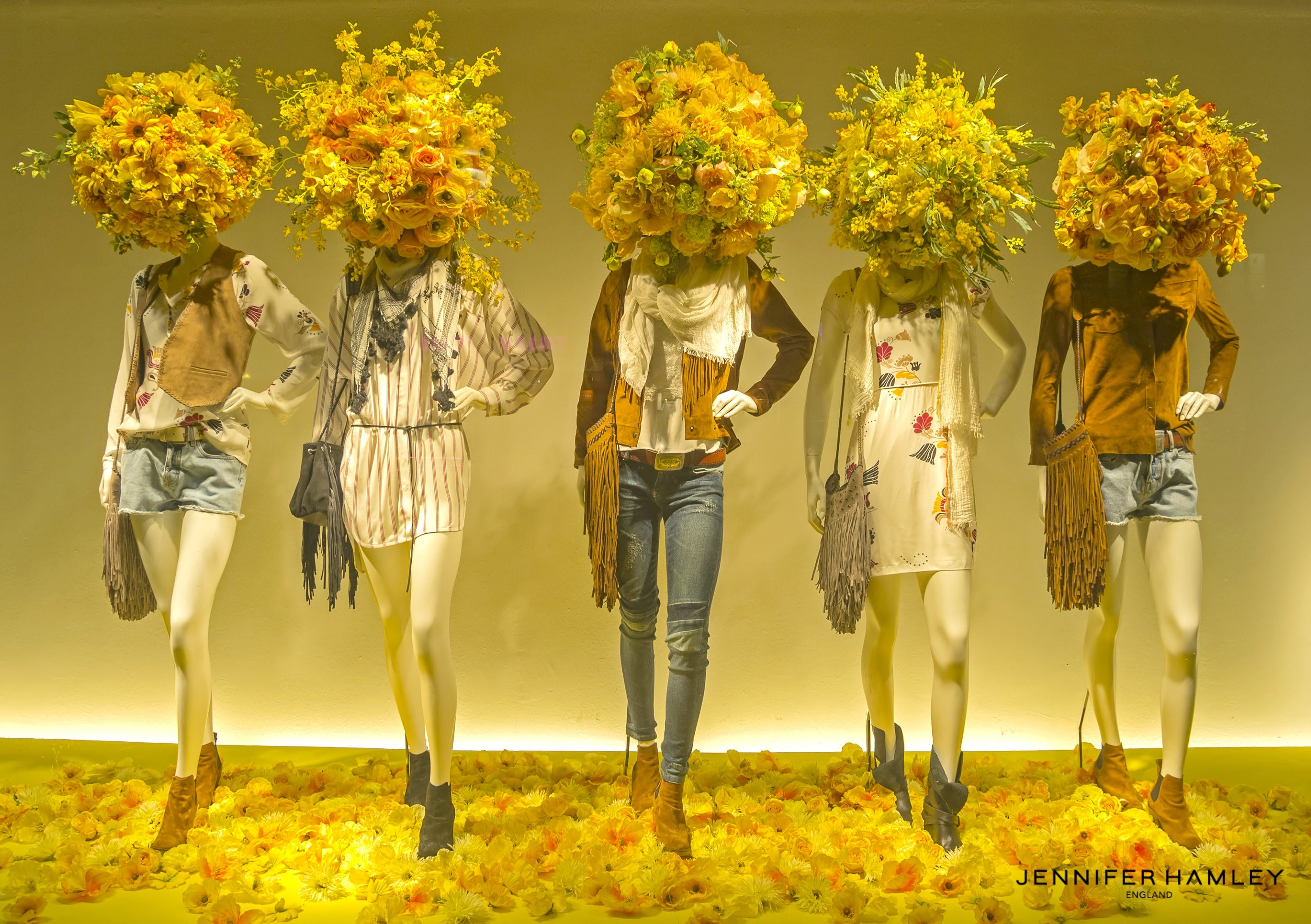 Mannequins in the showcase ofa  department store in Paris, France.