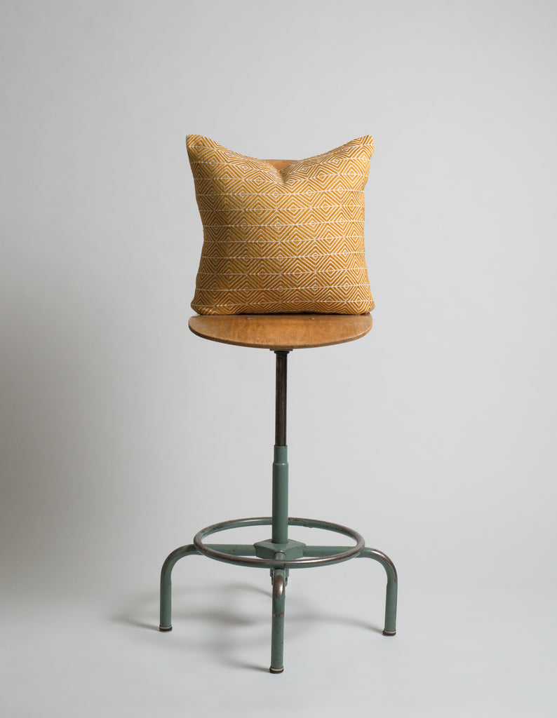 Handwoven geometric pillow. Yellow color.