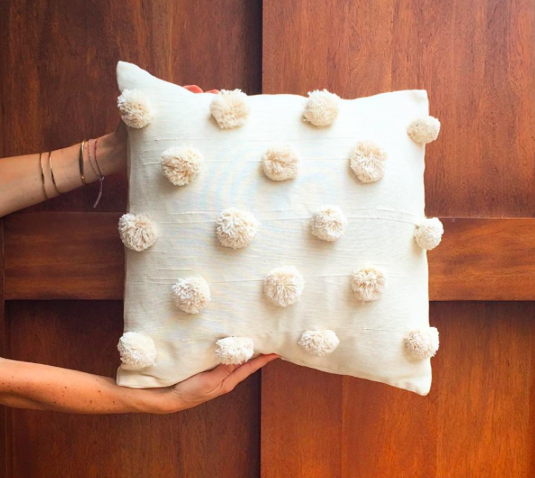 handwoven pom-pom pillow