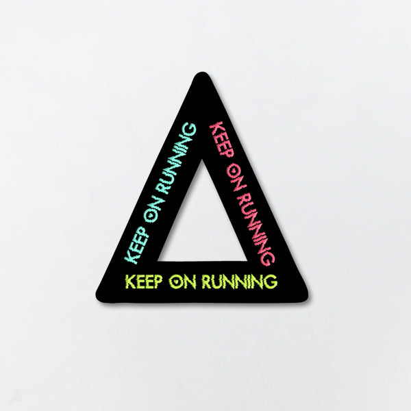 KEEP ON RUNNING ACRYLIC PIN