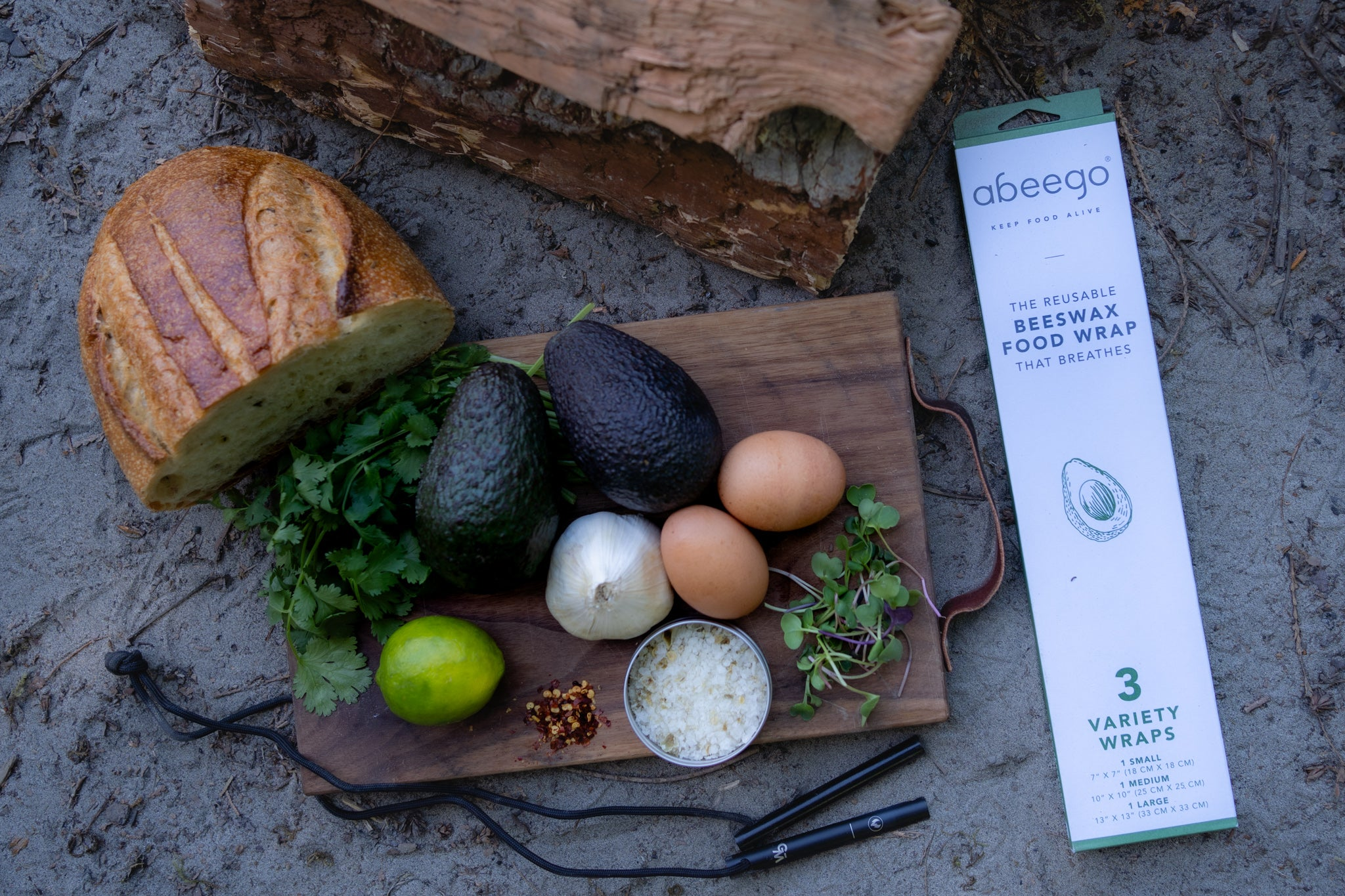 Produce on a cutting board with Wolf and Grizzly's Fire Set and Abeego Food Wraps