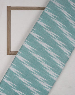 White & Turquoise Woven Ikat Cotton Fabric - Fabriclore.com