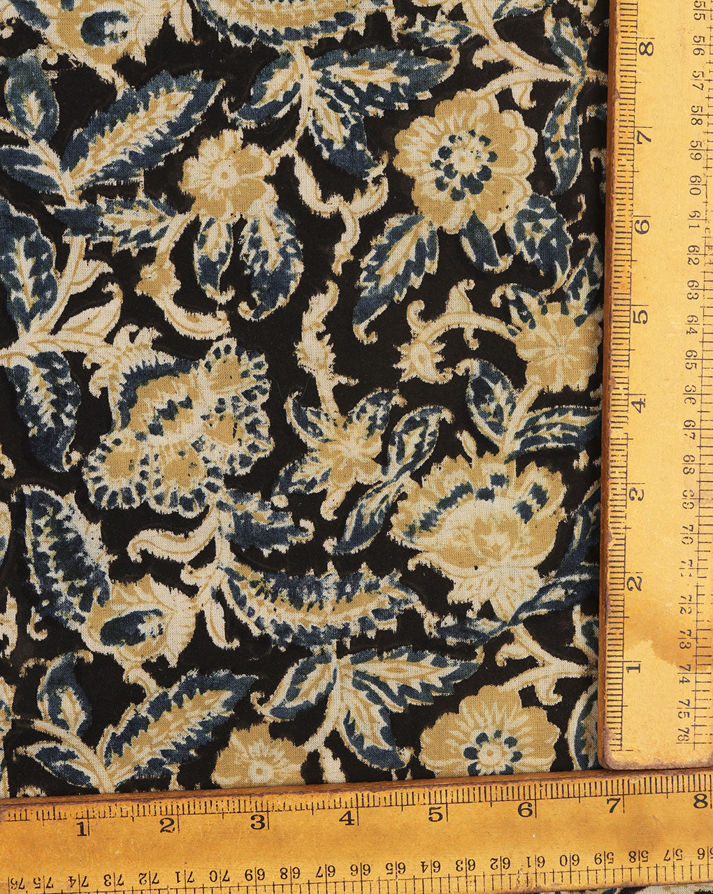 Black & Yellow Floral Kalamkari Hand Block Cotton Fabric - Fabriclore.com