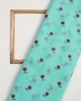 Turquoise & Red Floral Embroidery Georgette Fabric - Fabriclore.com