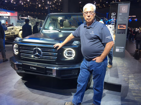 Karl at the Detroit Auto Show in front of the new 2019 G-Wagen