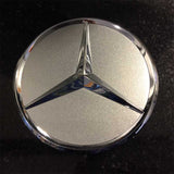 Silver metallic with chrome star Mercedes-Benz center cap