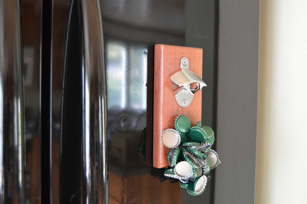 Mahogany magnetic bottle opener by Nason's of Maine close on fridge